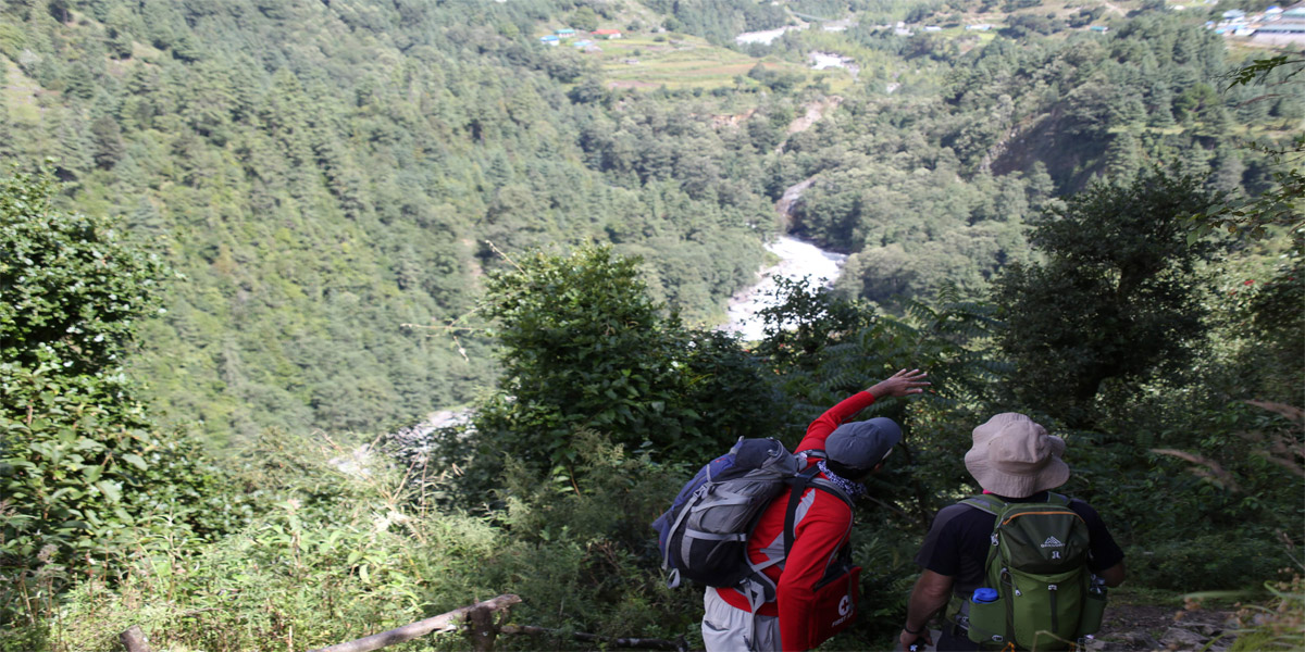 Trekkers looking at Phakding on Everest Base Camp Trail